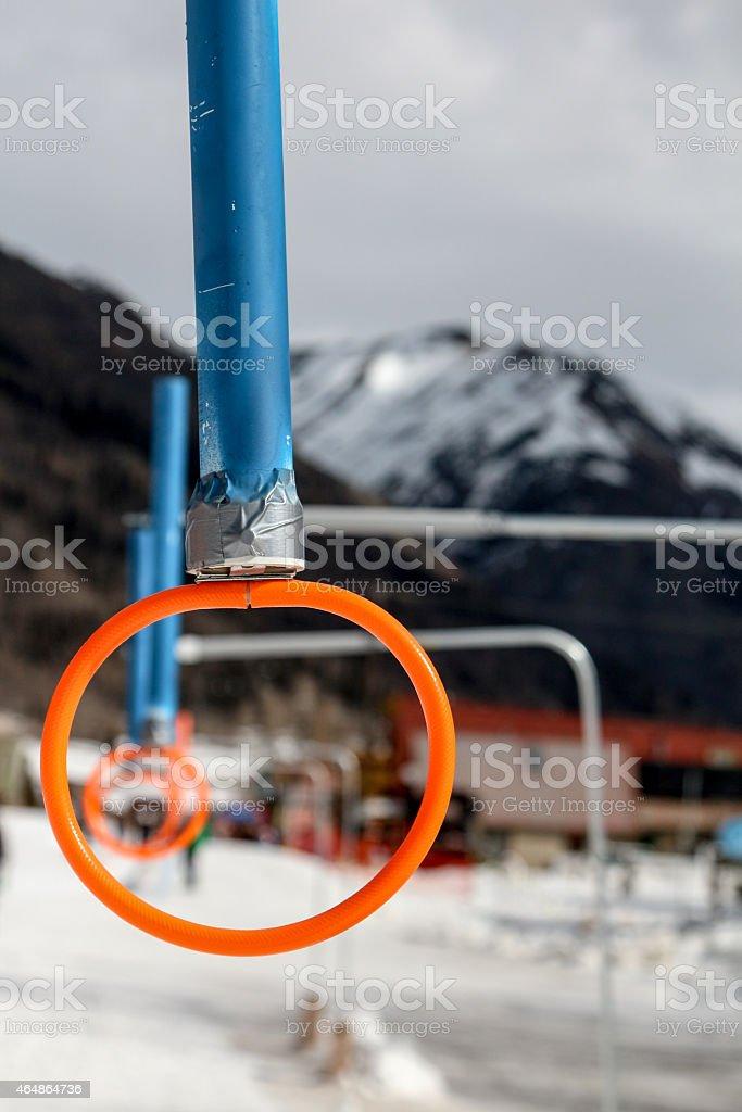 Orange plastic ring, Skijoring equipment at a race stock photo