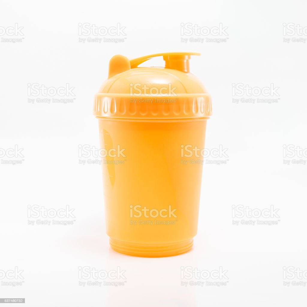 Orange plastic shaker used for mix your protein powder stock photo
