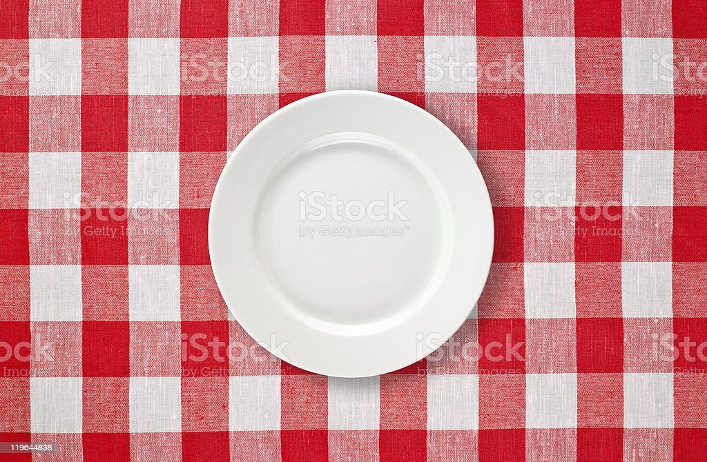 orange plate on red checked tablecloth royalty-free stock photo