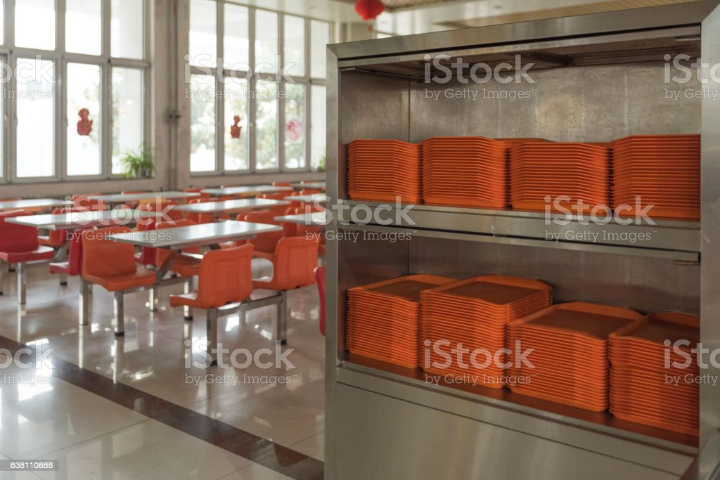 orange plates in mess hall stock photo