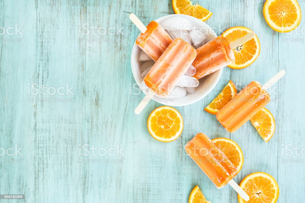 Orange Popsicle Summer Snack with Fruit Slices stock photo