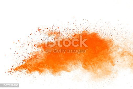 Orange powder explosion. The particles of charcoal splatter on white background. Closeup of orange dust particles splash isolated on background.