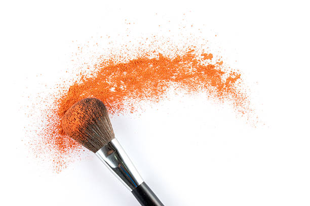orange powder eyeshadow on a brush, fashion beauty - 舞台化妝 個照片及圖片檔