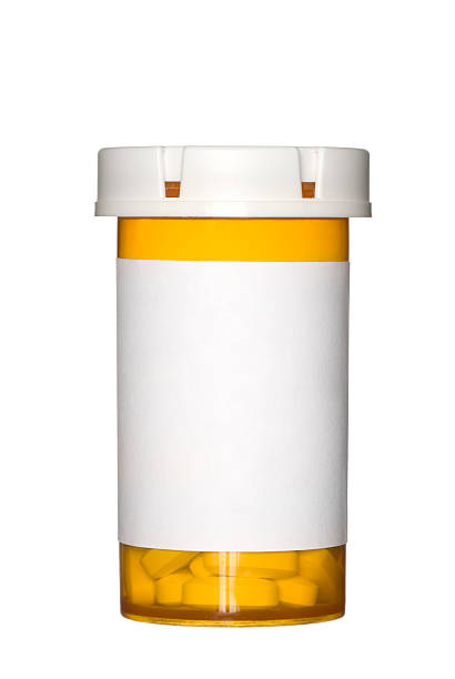 orange prescription pill bottle on white background - prescription medicine stock pictures, royalty-free photos & images