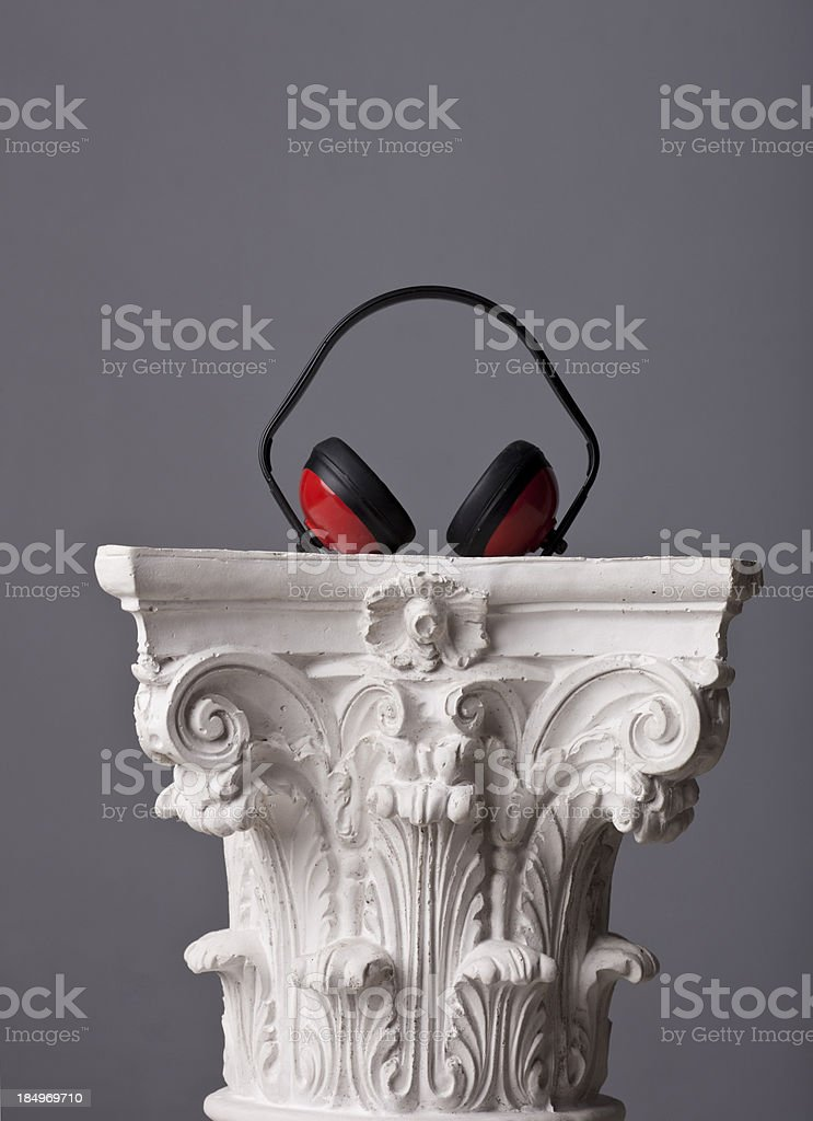 orange protection headset on a corinthian capital royalty-free stock photo