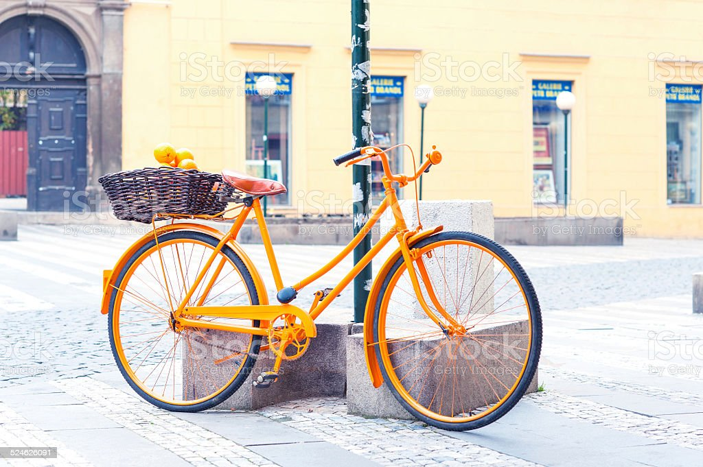 Orange provence rural bicycle with fruits in wicker basket. stock photo