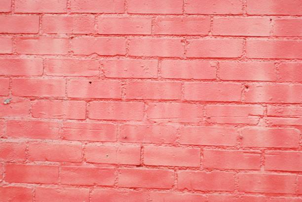 orange rot bemalten stein ziegel wand textur im freien gebäude wallpaper - betonwerkstein stock-fotos und bilder