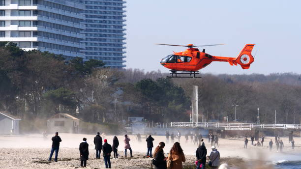 Orange rescue helicopter that has landed on the beach stock photo