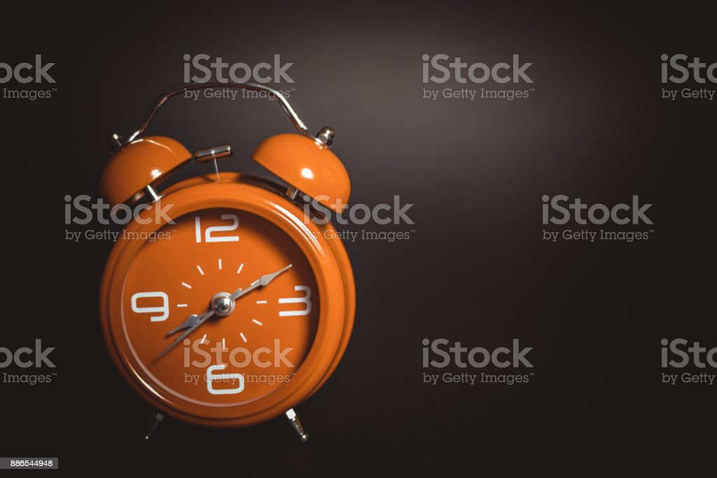 Orange retro alarm clock. stock photo