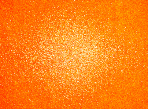 orange rind painted texture/background with white paint