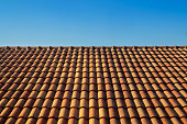 orange roof tile house against blue sky and warm sunlight at the summer time. housing and real estate concept.\