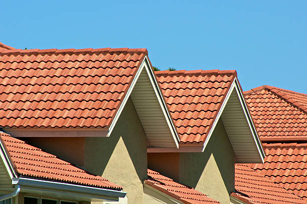 Orange rooftops of joined townhouses stock photo