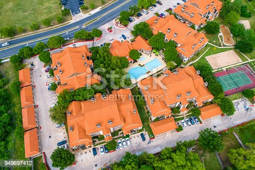 istock Orange Rooftops Suburb New Development Townhomes - Aerial View straight down angle - 949697412