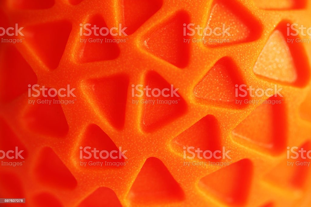 Orange rubber texture with triagle pattern stock photo