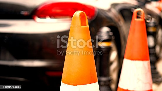 157590217 istock photo Orange rubber traffic cone on country road. It is used for warning to broken down car on country road 1138580036