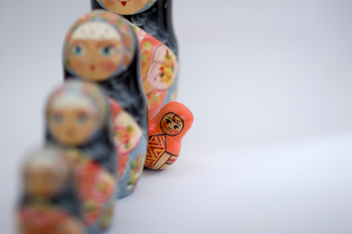Orange Russian Nesting Doll Standing Out Stock Photo - Download Image Now