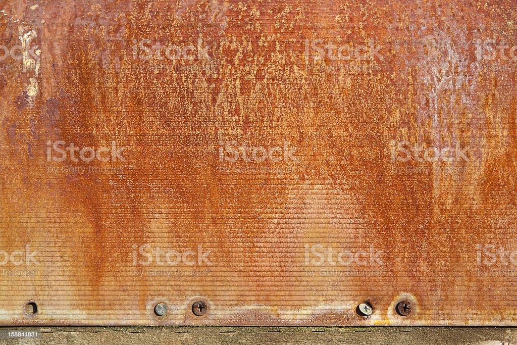 Orange Rust on Metal Wall royalty-free stock photo