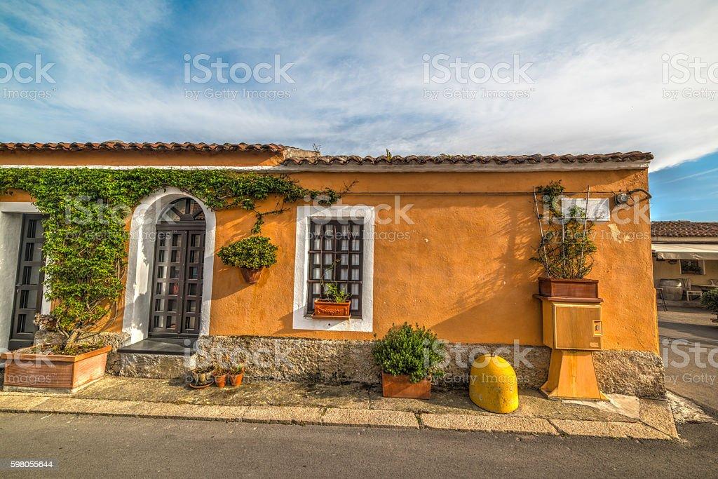 orange rustic wall in Sardinia stock photo