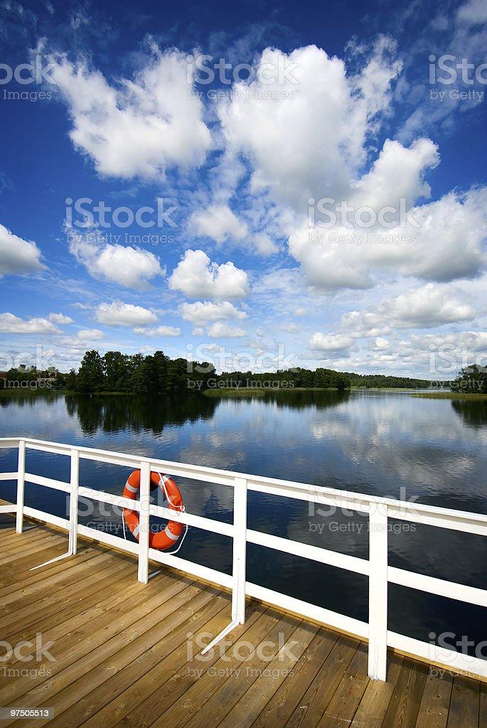 Orange safe guard ring against sea background royalty-free stock photo