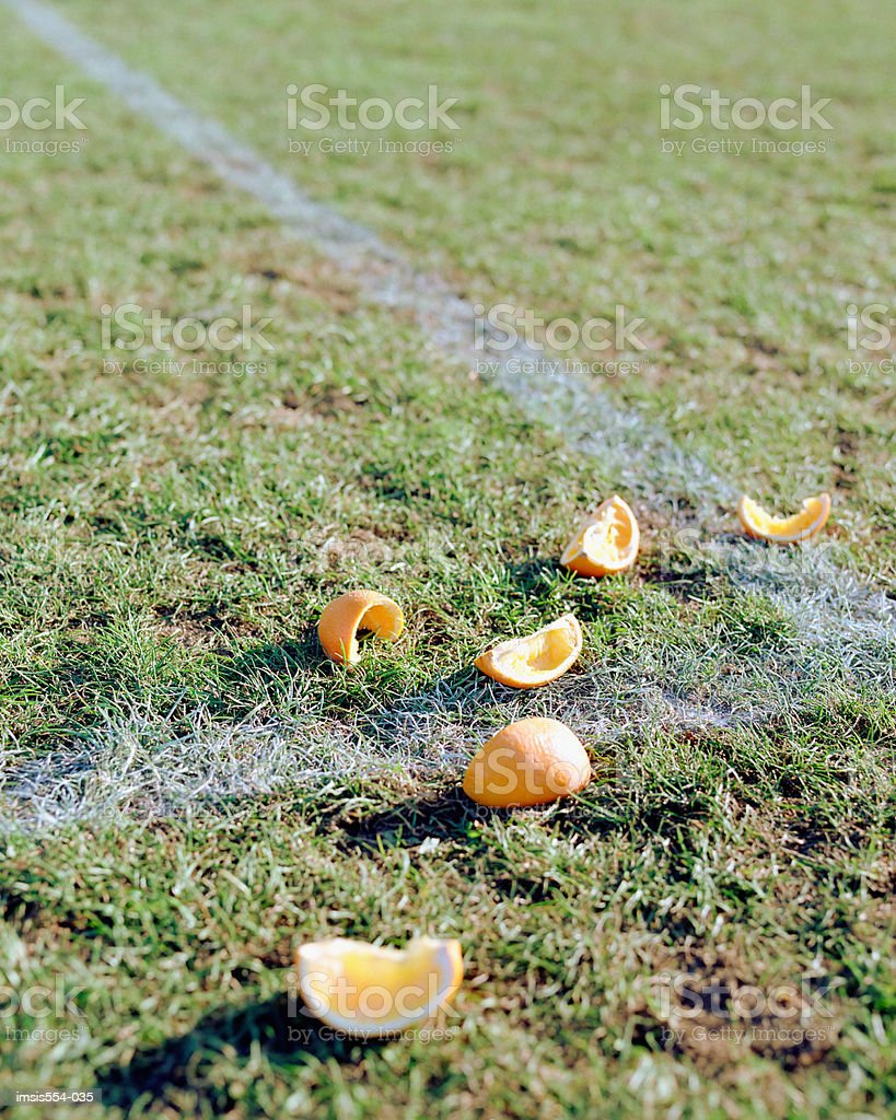 Orange segnments on soccer field foto royalty-free