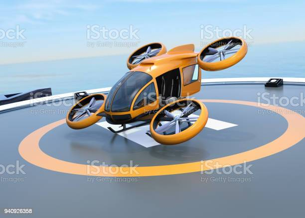 Orange selfdriving passenger drone takeoff from helipad picture id940926358?b=1&k=6&m=940926358&s=612x612&h=yebj1nqcy7lfg hg4vibdycpy uhyarbhxf2vpz1wzo=