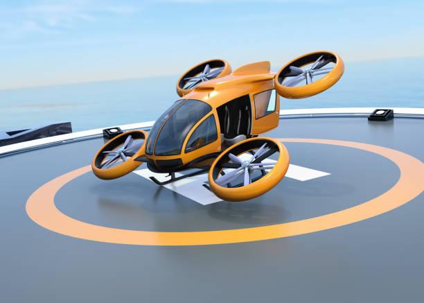 orange, selbstfahrender passagier drohne start vom hubschrauberlandeplatz - flugdrohne stock-fotos und bilder