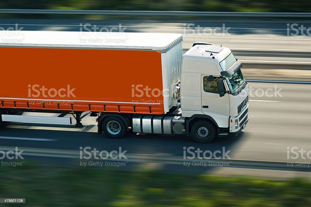 orange semi truck stock photo