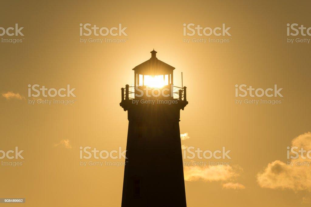 Orange silhouette lighthouse stock photo