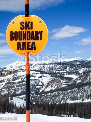 Ski resort signage warning of the ski area boundary.  These markers keep skiers and snowboarders from accidentally leaving the ski resort.