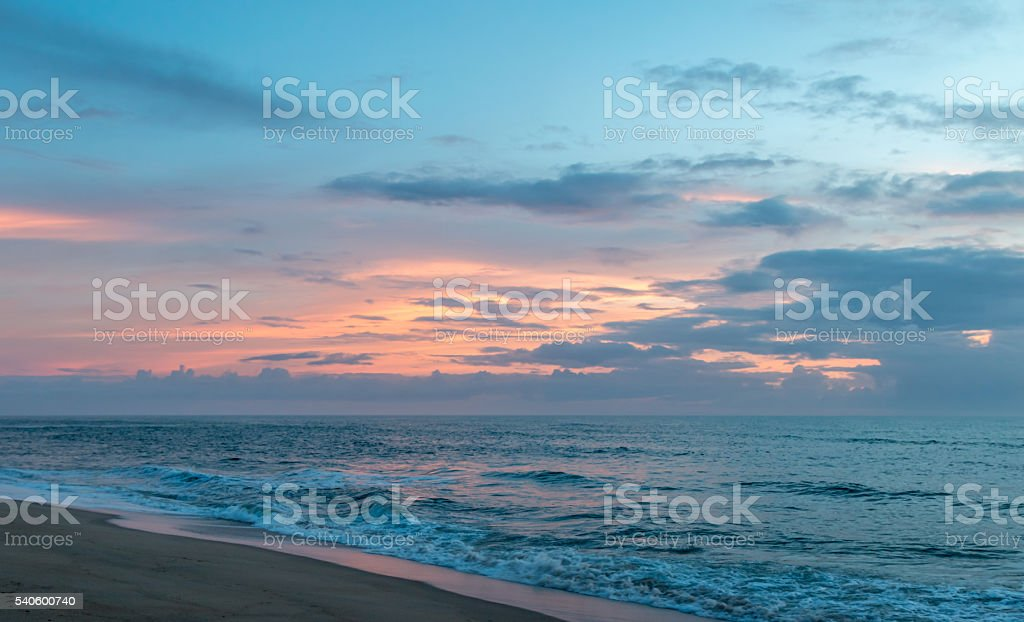 Orange Skies during a Beach Sunrise stock photo