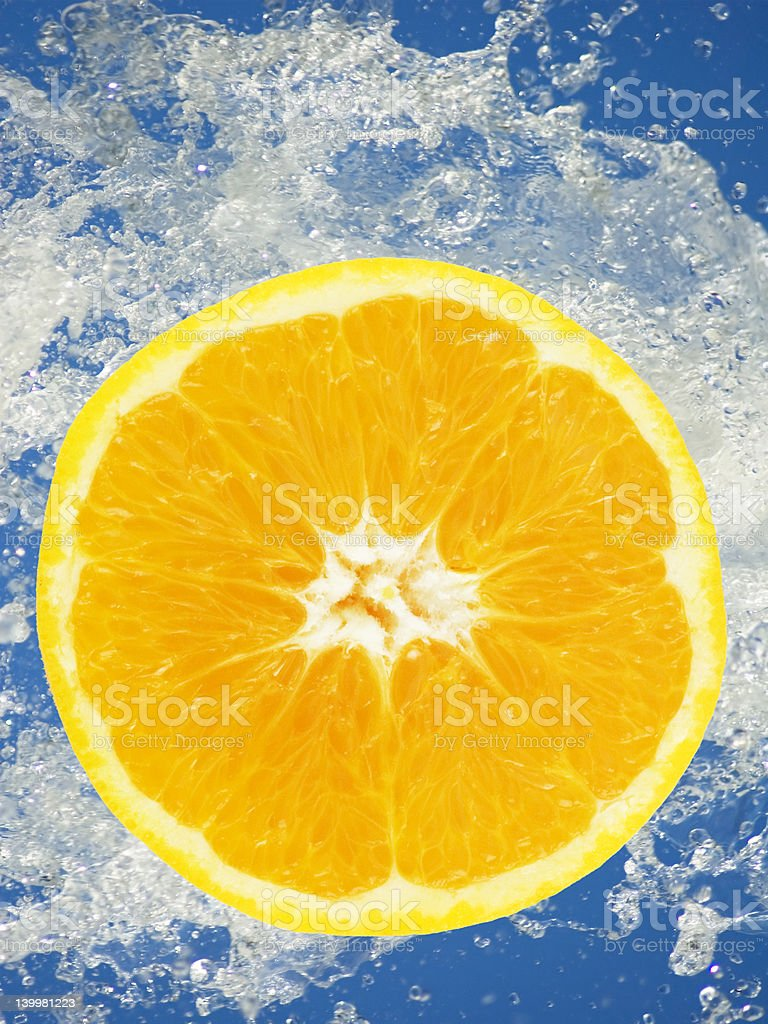orange slice in the water stock photo