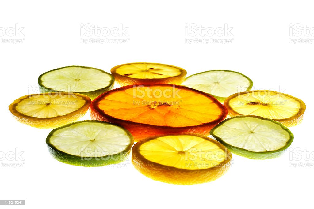 Orange slice surrounded with lemon and lime slices royalty-free stock photo