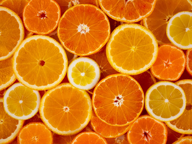 Orange slices background. Citrus fruits. stock photo
