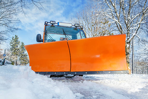 Orange snowplough 스톡 사진