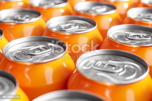 istock Orange soft drink cans. Macro shot 947995270