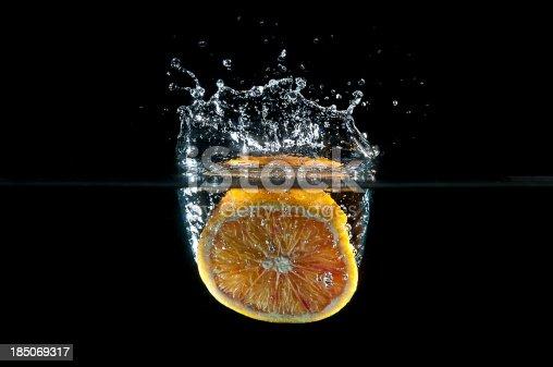 1169153675 istock photo orange splashing into water 185069317