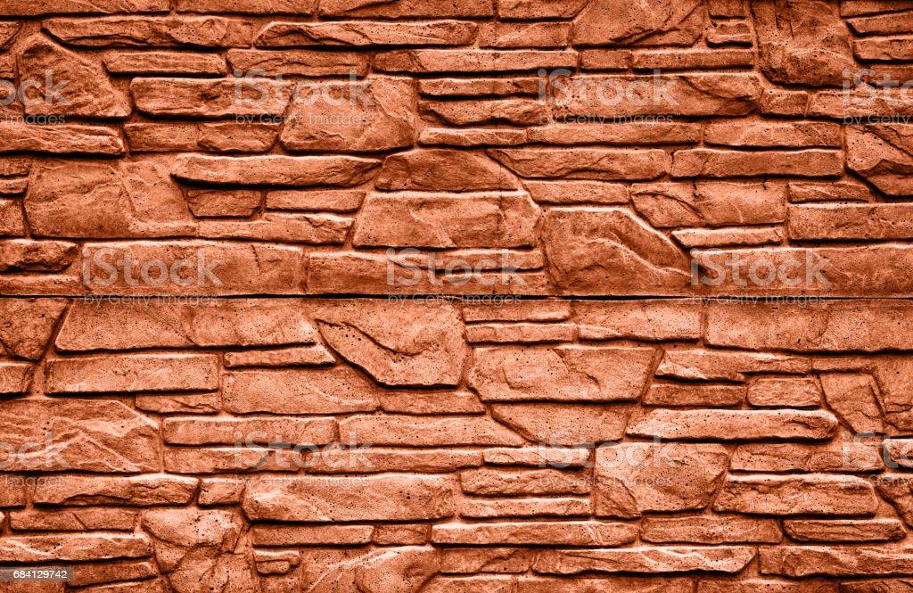Orange stone brick wall detailed contrast texture background royaltyfri bildbanksbilder