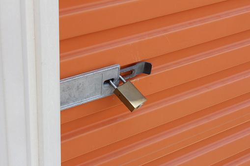 Orange Storage Door With Padlock Stock Photo Download