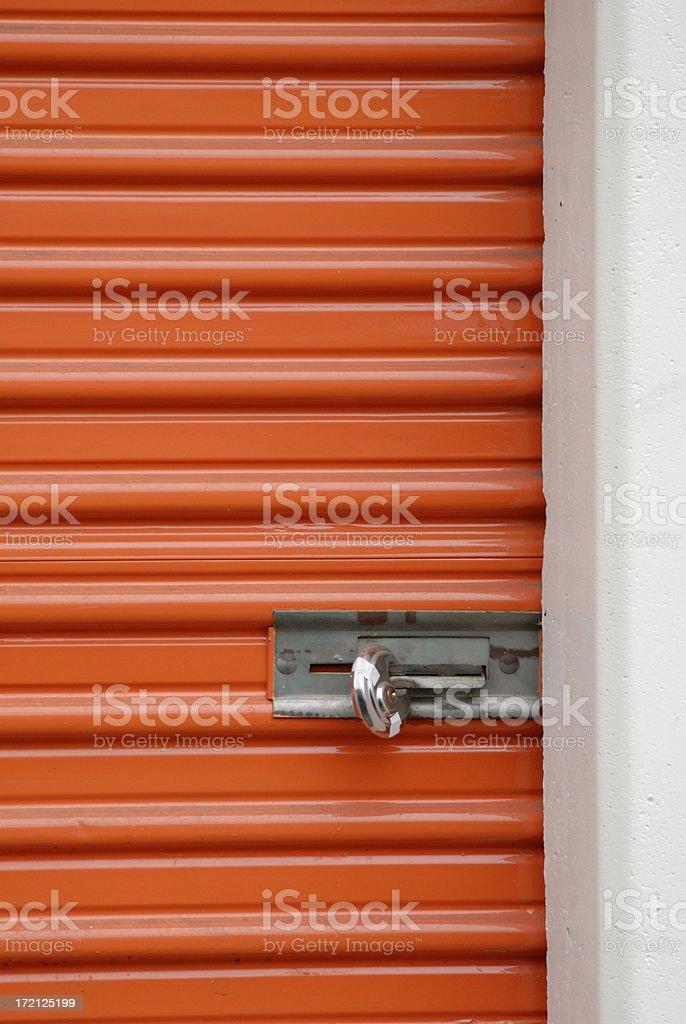 orange storage steel door with padlock royalty-free stock photo