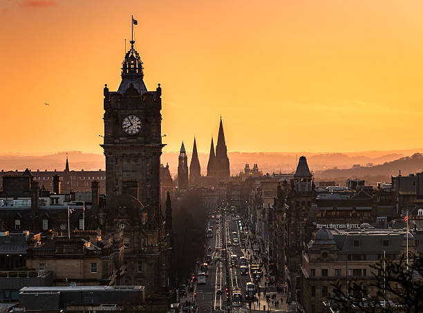 Orange Street A lovely sunset over Edinburgh's Princes Street, Scotland, UK princes street edinburgh stock pictures, royalty-free photos & images