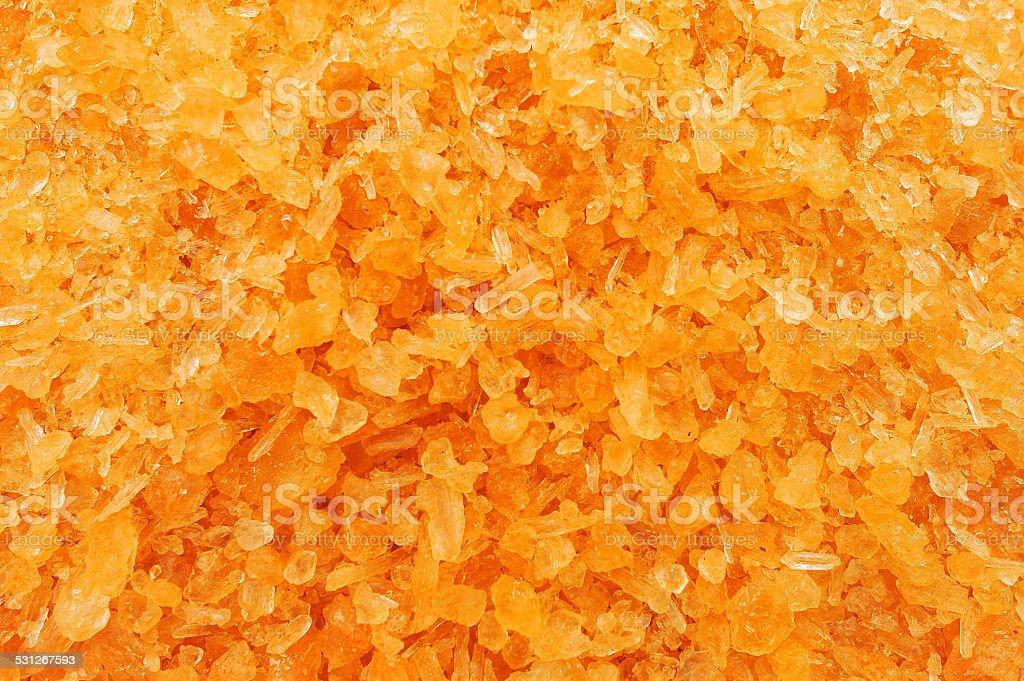 Orange sugar crystals stock photo
