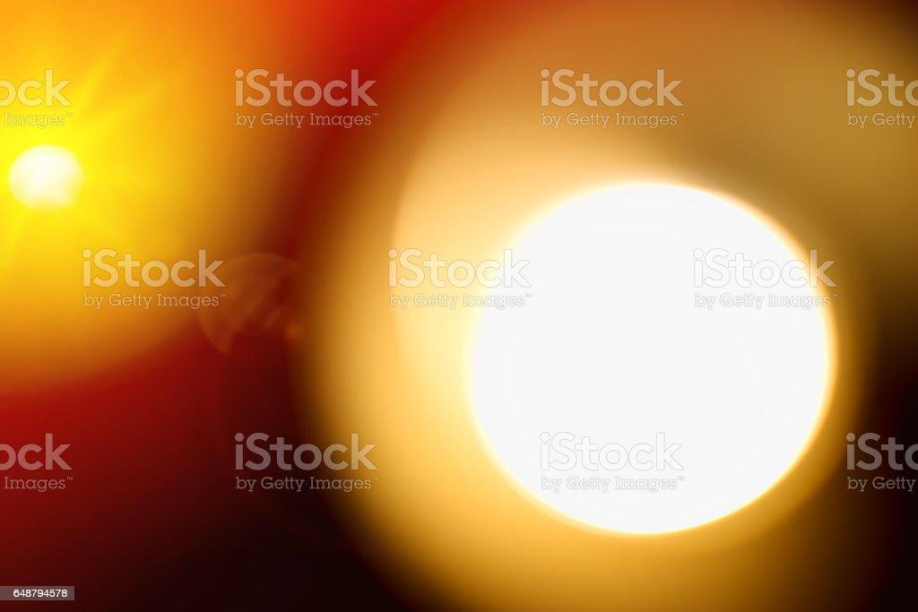 Orange sun on black background with optic flare stock photo