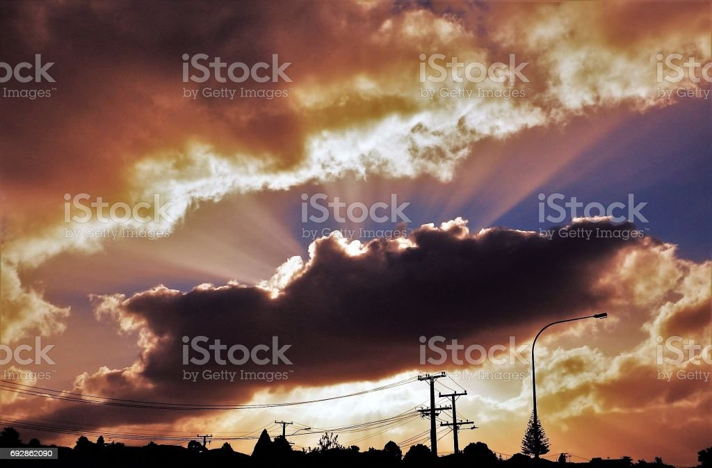 Orange Sun Rays Dark Cloud stock photo