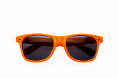 Orange sunglasses on white background