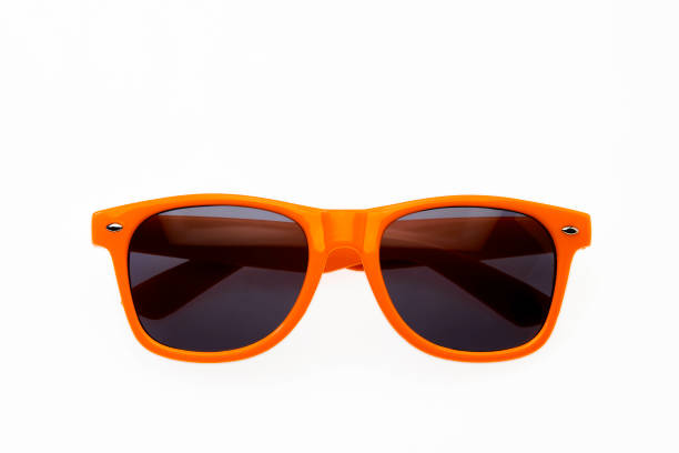Orange sunglasses on white background stock photo