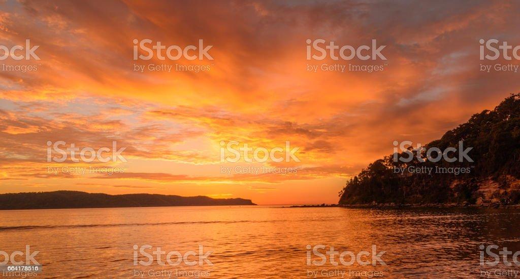 Orange Sunrise Seascape with Cloudy Sky stock photo
