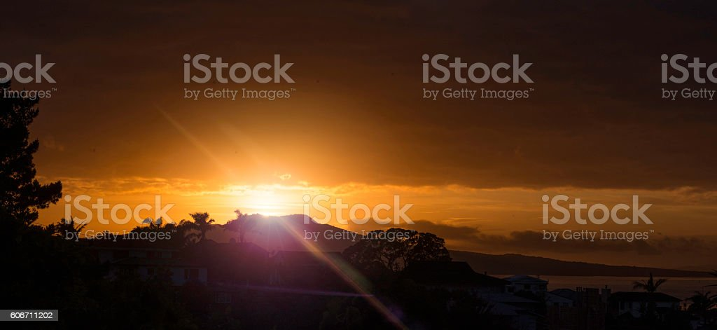 Orange sunrise with flare stock photo