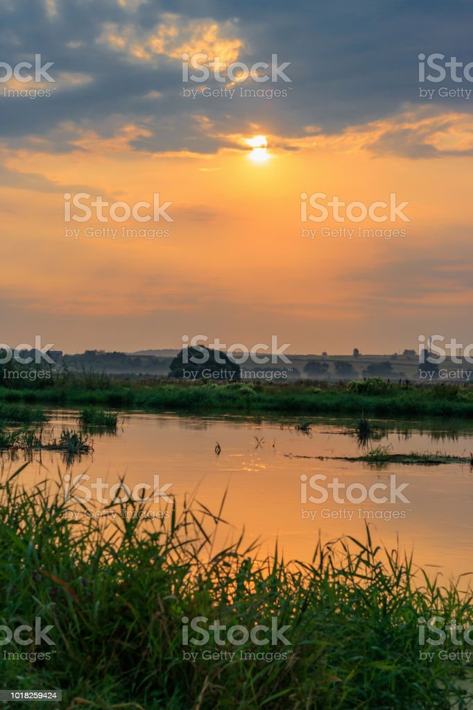 Orange Sunset Above Small River At Summer Evening River