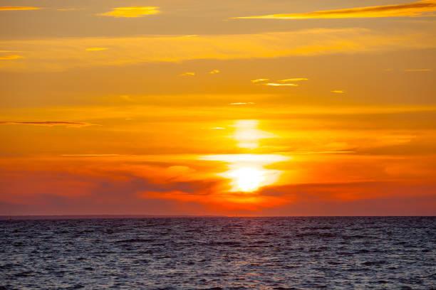 Orange sunset at summer over Baltic sea stock photo