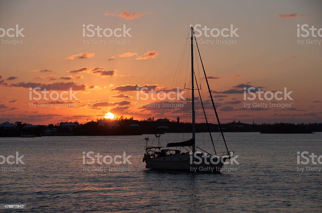 Orange Sunset Bermuda- sailboats near Hamilton stock photo